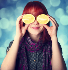 Chill girl in scarf keep lemon instead of eye