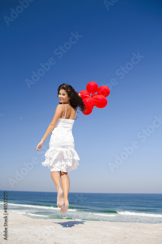 Jumping with red ballons