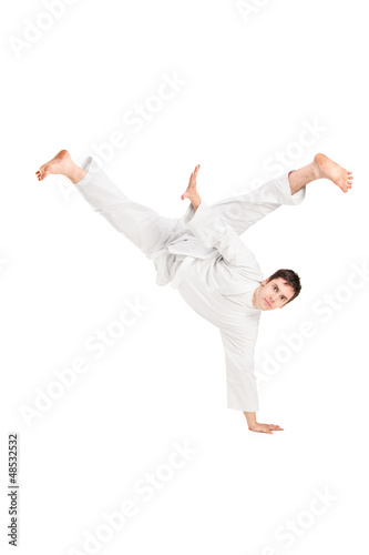 A young karate man performing