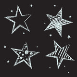 Set of hand drawn stars on chalkboard background.