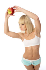 Athletic girl offering an apple