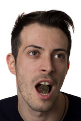 Man holding a coin in the mouth