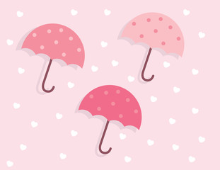 Three pink colored umbrellas floating