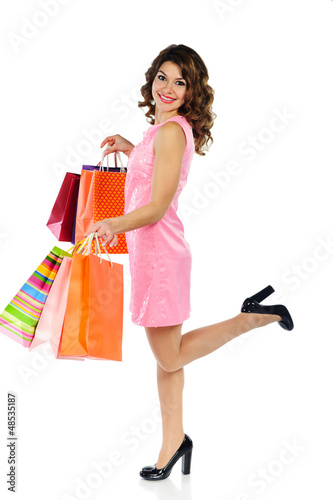Young beautiful woman with shopping bags isolated on white