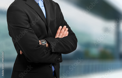 Businessman's crossed arms