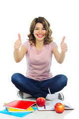 Happy female student showing thumbs up isolated on white