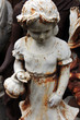 Garden figurines at the flea market. Paris, France.