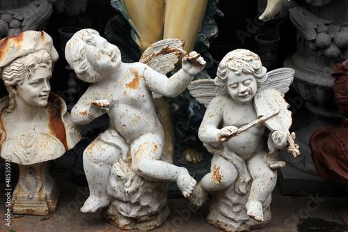 Angels at the flea market. Paris, France.