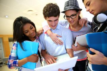 Group of students standing in school hallway