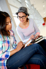 Student girls using smartphone at school