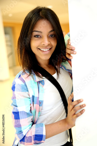 Student girl standing in college building