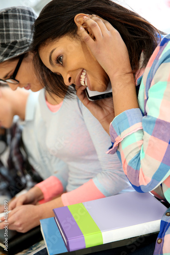 School girl talking on mobile phone