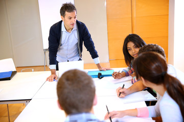 College teacher in class with group of students
