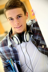 Trendy young student boy with music headphones