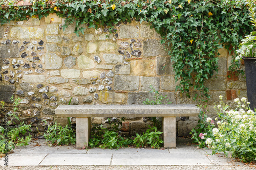 Leinwandbild Motiv Bench in formal garden