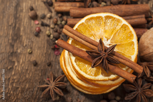 Different kinds of  spices and dried oranges