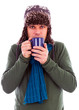 Young man warming up with hot tea