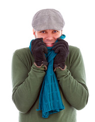 Young man with gloves and scarf  shivering  from cold