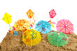 Colorful parasols and kites at the beach