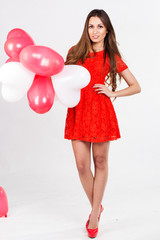 Valentines day woman holding red heart balloons