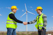 Engineers giving Handshake in a Wind Turbine Power Station