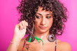 Young Woman Cutting her Curly Hairs