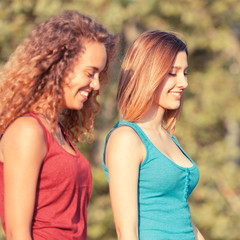 Two Beautiful Teenage Girls Walking at Park