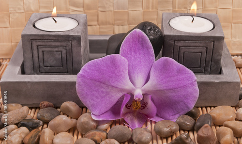 Candles, stones and orchid
