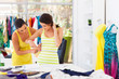 female tailor measuring customer waist size