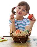 little girl painting easter eggs white background