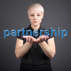 Partnership business concept - woman and word