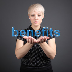Benefits concept - Business Woman with word