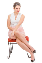 Attractive young woman in skirt sitting cross legged