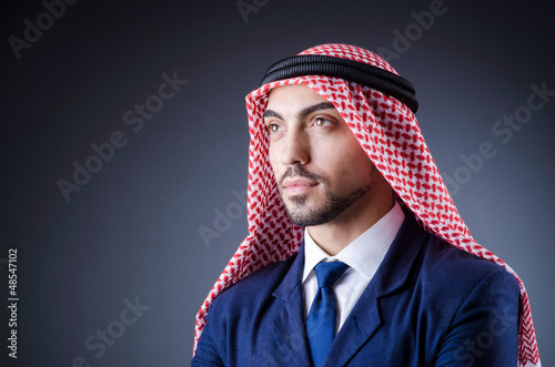Arab businessman isolated in dark room
