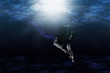 Beautiful mermaid swimming