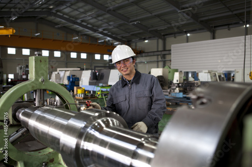 asian technician working in factory