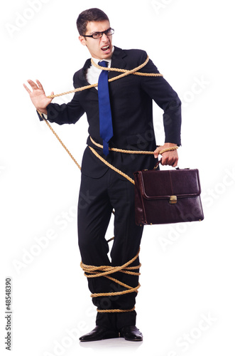 Businessman tied up with rope on white