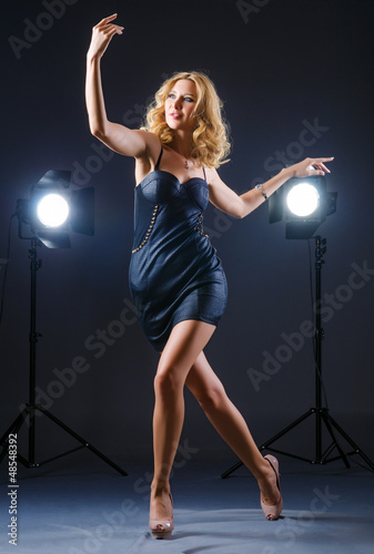 Attractive woman posing in photo studio