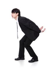 man holding something heavy on his back