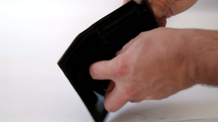 Hand extracting money US dollars from the wallet