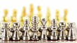 Small golden and silver chess figures in start position