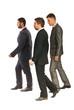Profile of business men walking