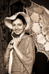 woman in old hat with a lace umbrella
