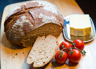 fresh farmhouse bread with butter and tomato