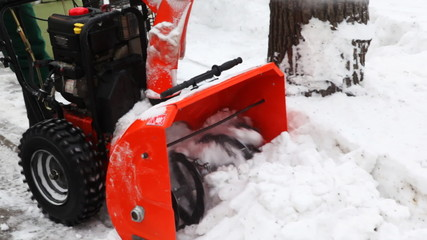 close-up of small manual machine that breaks snow lumps