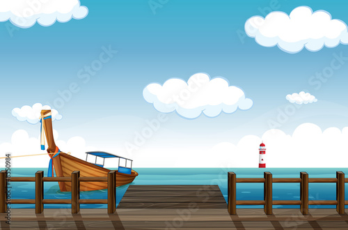A docked boat and lighthouse