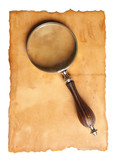 Magnifying glass and old paper
