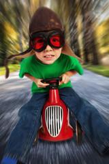 Boy on toy racing car