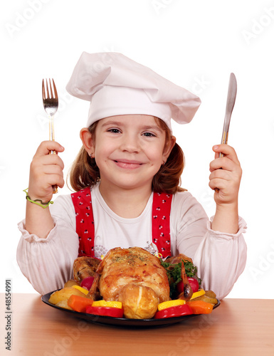 little girl cook with grilled chicken