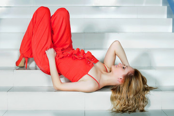 woman in a red pantsuit